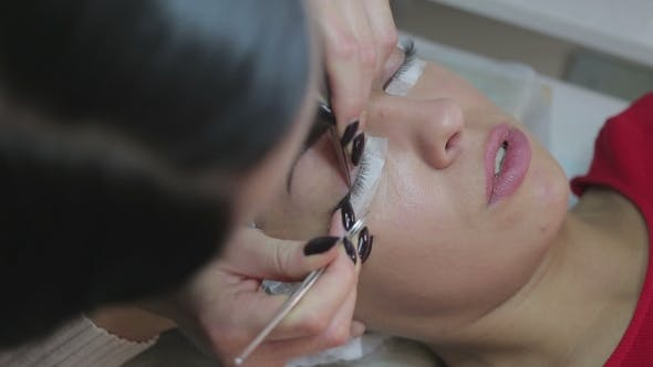 Thumbnail for Eyelash Extension Procedure Woman Eye with Long Eyelashes