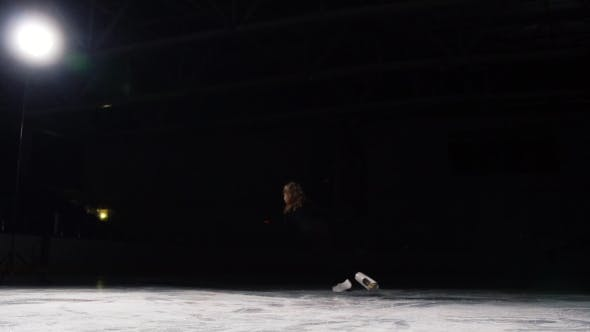 Thumbnail for A Professional Figure Skater Performs Skating with a Turn To Spin a Spinning Top with Her Axis on a