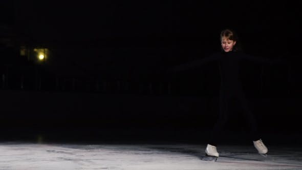 Thumbnail for A Professional Woman, a Figure Skater To a Black Suit at a Figure Skating Competition, Enters the