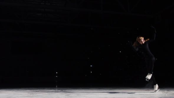 Thumbnail for A Professional Woman, Figure Skater To a Black Suit at the Competitions in Figure Skating, Performs