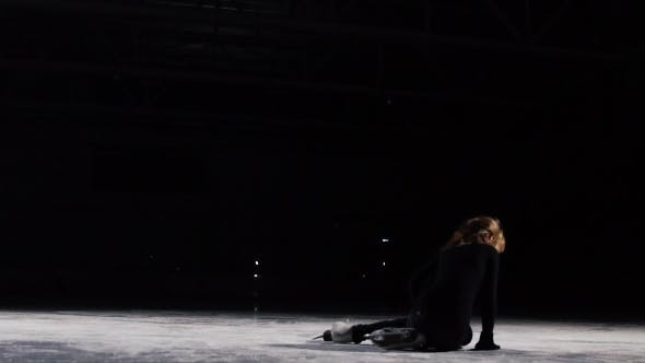 Thumbnail for A Professional Woman Figure Comes Up After Falling on the Ice and Shakes Herself Off and Continues