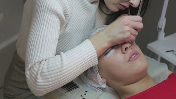 Thumbnail for Eyelash Extension Procedure. Woman Eye with Long Eyelashes