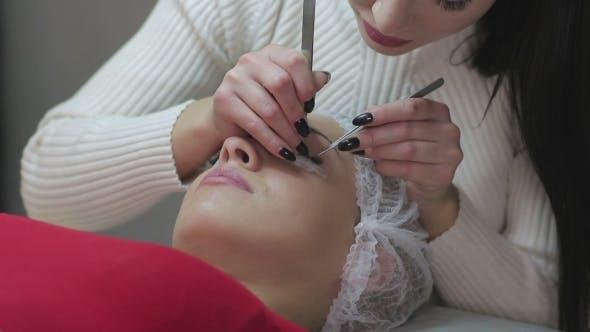 Thumbnail for Eyelash Extension Procedure. Woman Eye with Long Eyelashes