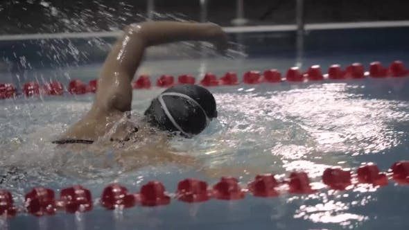 Female Professional Swimmer Turning Underwater on Swimming Pool
