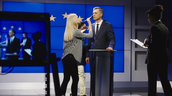 Thumbnail for Makeup Men Preparing Politician for Announcement