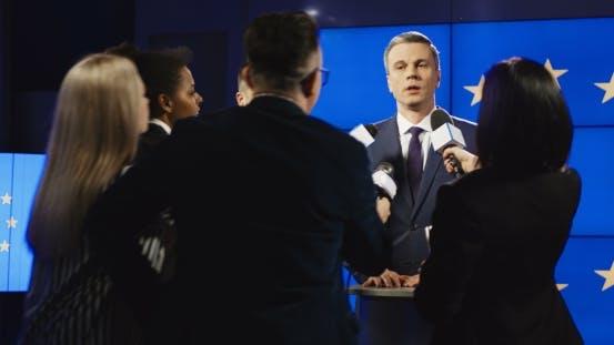 Thumbnail for Serious Businessman Talking To Mass Media Representatives
