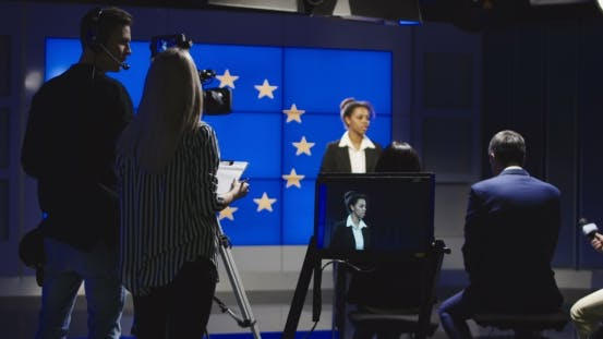 Thumbnail for Female News Anchor Reading the News