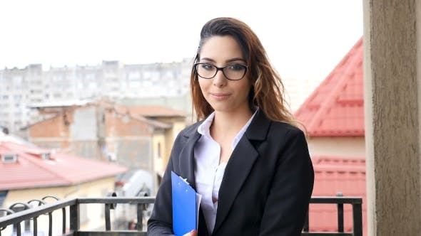 Thumbnail for Beautiful Brunette Woman in Business Suit Smiling To the Camera