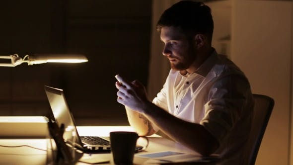 Thumbnail for Man with Laptop and Smartphone at Night Office 88