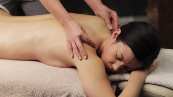 Thumbnail for Woman Lying and Having Back Massage at Spa 23
