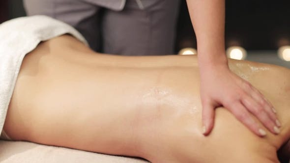 Thumbnail for Woman Lying and Having Back Massage at Spa 21