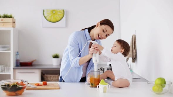 Thumbnail for Mother with Blender Cooking Baby Food at Home 8