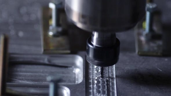 Cover Image for Milling Machine for Cutting Steel Handles a Piece of Aluminum The Drill Cuts the Inscription on the