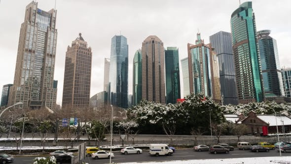 Thumbnail for Park with Trees and Road Covered with Snow Surrounded By Skyscrapers in the Pudong Area. Shanghai