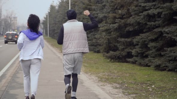 Thumbnail for Young People Running in  Along Urban Road