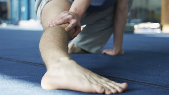 Thumbnail for Sportsman Stretching in Gym