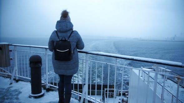 Thumbnail for Woman Photographing Frozen Sea From Ship