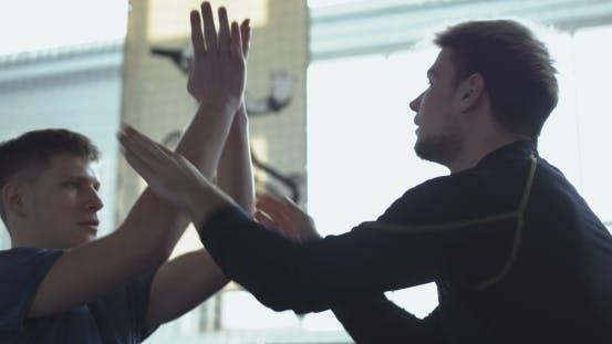Thumbnail for Men Training Fight Technique