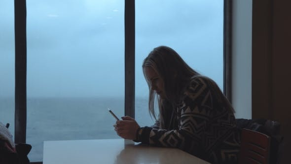 Thumbnail for Woman Using Phone in Ship Cabin