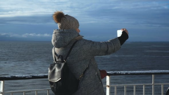 Thumbnail for Woman Taking Selfie on Cold Ship