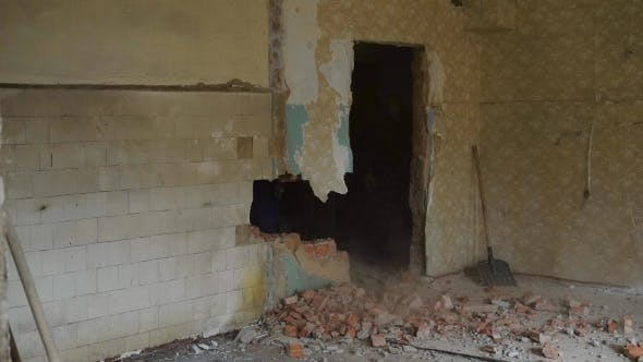 Thumbnail for Builder Is Breaking a Wall in Old Flat, Striking with a Sledgehammer in a Construction Site, Bricks