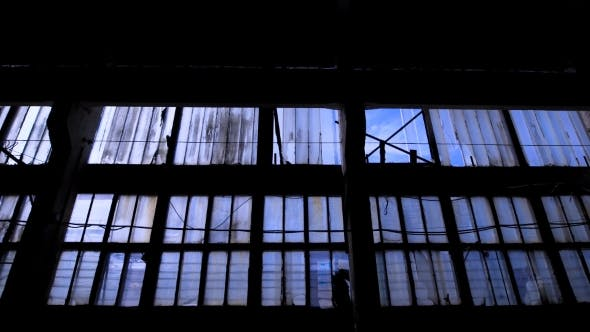 Thumbnail for Big Glass Wall of Old Empty Building with Many of Windows, Camera Is Moving Back in Dark Space