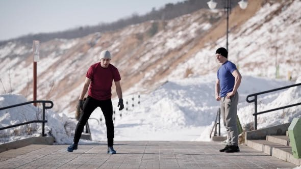 Thumbnail for Young Breakdancer Is Doing a Trick, Standing To Hand and Jumping with a Turnovers Outdoors in Winter
