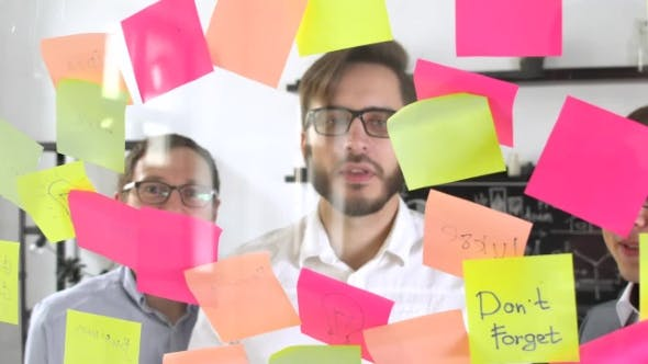Thumbnail for Man Post in Sticky Note While Meeting in Office on the Sticker Is Written YES