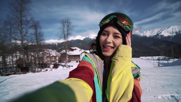 Thumbnail for Snowboarder Woman Making Selfie