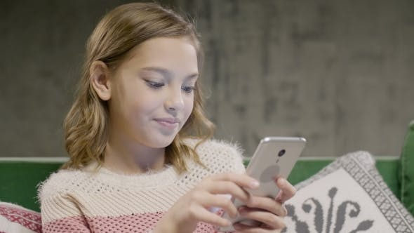 Thumbnail for Teen Girl Chat with Friend By Smartphone at Home