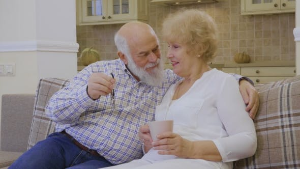 Thumbnail for Happy Old Couple with Keys From a New House