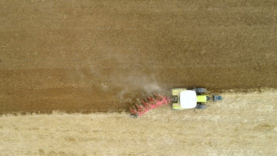 Thumbnail for Tractor Plowing Field - Aerial View