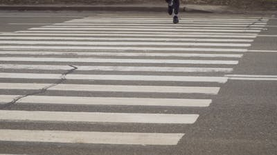Sportsman Runs through Crosswalk
