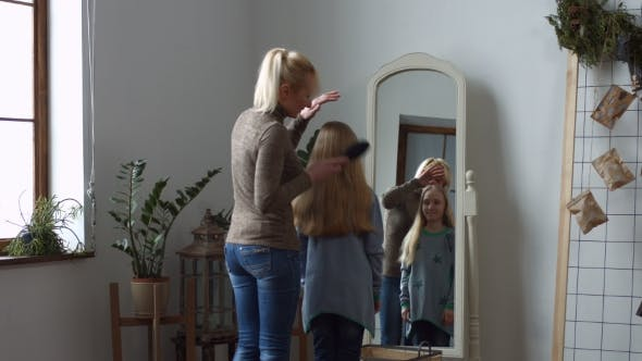 Thumbnail for Lovely Mother Combing Her Daughter's Hair at Home