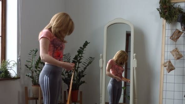Thumbnail for Middle Aged Woman Measuring Her Waist with Tape