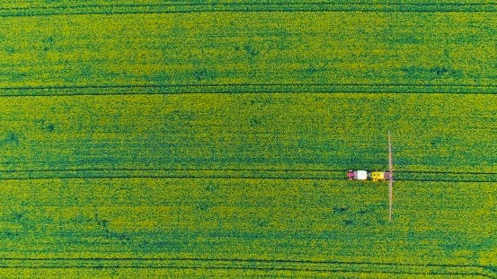Thumbnail for Agriculture Aerial Tractor Spraying Chemicals on Field