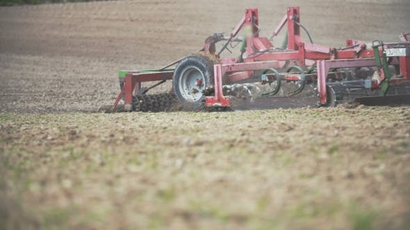 Thumbnail for Agriculture Background. Farmer Cultivating Field Using Harrows - .
