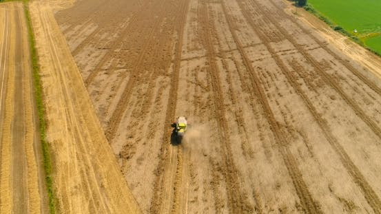 Thumbnail for Combine Harvester Gathers Agricultural Field.