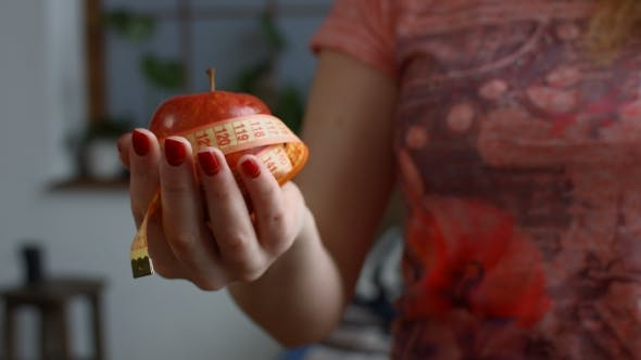 Thumbnail for Woman Holding Fresh Apple and Measure Tape