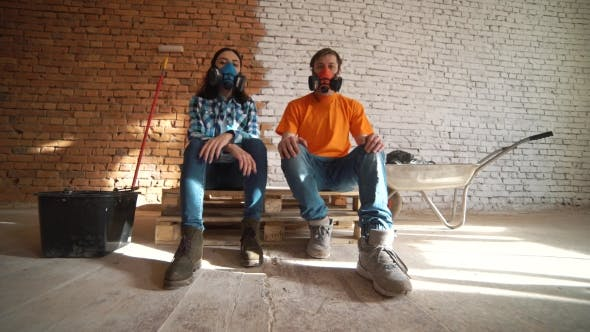 Thumbnail for Wife and Husband Sit in Respirators Tired after the Working