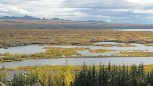 Thumbnail for Picturesque Fall Landscape of River in a National Icelandic Park with Yellowed Grass and Moss