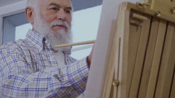 Thumbnail for Senior Man Draws Picture Enjoying the Process of Drawing