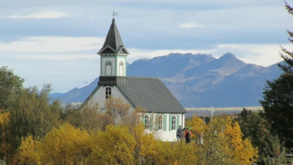 Thumbnail for Old Traditional Icelandic Building in a Park in Autumn Day in Background of Mountain