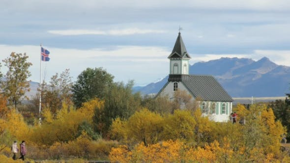 Thumbnail for People Are Strolling in a National Icelandic Park in Autumn Day Near Old Building Against Mountain