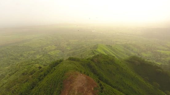 Thumbnail for Bird's Eye View Video on a Beautiful Mountain Covered with Green Grass.