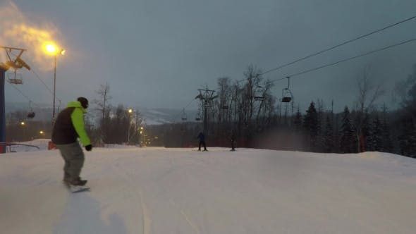 Thumbnail for The Snowboarder Descends the Slope at High Speed