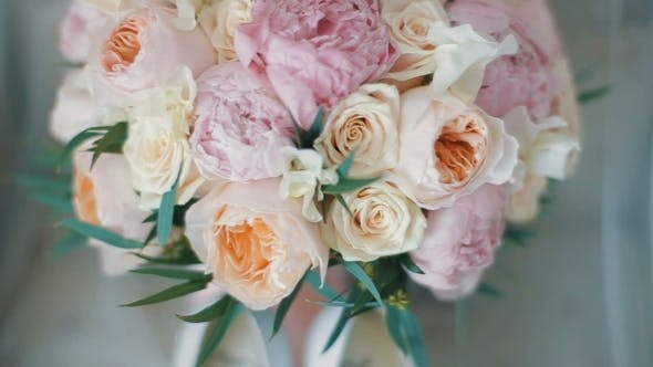 Wedding Bouquet of Roses and Peonies. Bridal Bouquet on Wedding Day. Bouquet of Different Flowers