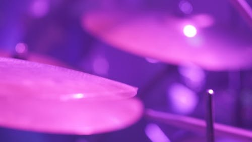 Musician Playing Drums During Rock Concert