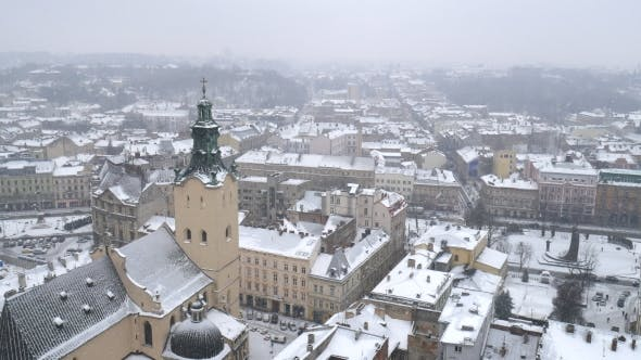 Thumbnail for Snow Storm in Old Europe City. Heavy Snow Falling in the Middle of Winter.