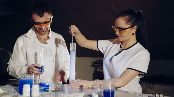 Thumbnail for Two Chemists Examine Various Liquids in the Tubes. Experiments in the Laboratory